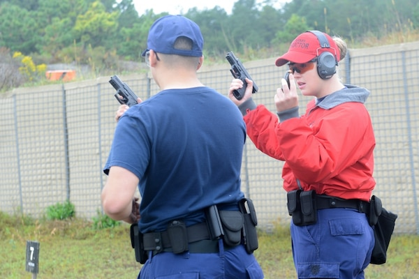 Coast Guard Petty Officer 2nd Class Cassandra Kintzley, a gunner's mate at Coast Guard Sector Boston, works at the Fort Devens firing range, in Massachusetts, Wednesday, September, 20, 2017, to qualify Coast Guard members in weapons handling. Kintzley, a highly skilled shooter, trains Coast Guard men and women who enforce maritime laws, and protect Northeast ports and waterways. U.S. Coast Guard photo by Petty Officer 2nd Class Cynthia Oldham.