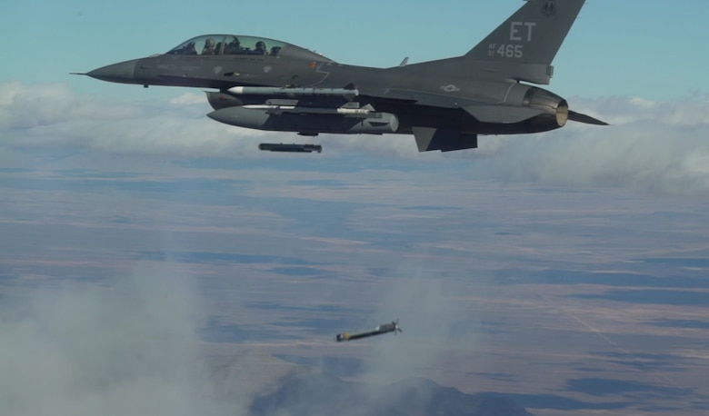 Collaborative Small Diameter Bombs (CSDBs) are launched from the wing of an F-16 fighter from the Air Force Test Center's 96th Test Wing at Eglin AFB. Four of the bombs were dropped during the second flight demonstration of the Air Force Golden Horde Vanguard on February 19th. (Courtesy photo)