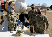 As we honor the Construction Battalion today, Navy Expeditionary Combat Command, NECC, Heaquarters celebrated with a cake cutting and singing of the Seabee song. L to R Lt. Dylan Berns, Capt. Richard Hayes and CUCM Michael 'Shane' Jenkins.