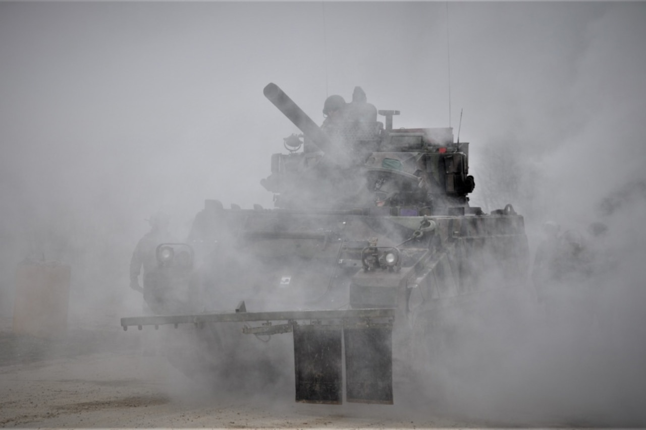 Soldiers in a tank take part in a NATO-led exercise.