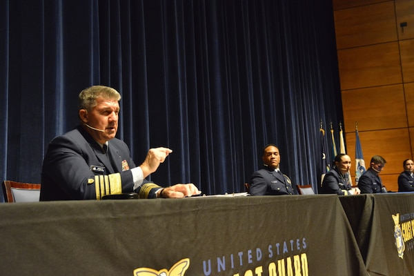 U.S. Coast Guard Adm. Karl Shultz, commandant of the Coast Guard, alongside a panel of six selected junior officers, address cadets at the Coast Guard Academy, New London, Connecticut, March 3, 2021. The panelists discussed their own personal experiences in the field to give insight into what lies ahead once the cadets join the fleet as officers. (U.S. Coast Guard photo by Petty Officer 2nd Class Ronald Hodges)