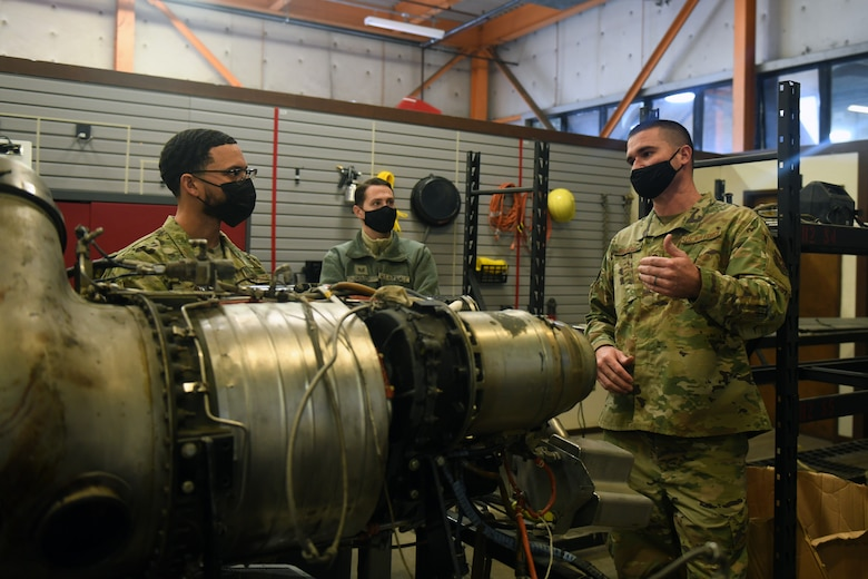 Senior Master Sgt. Matthew Parker, 349th Maintenance Group quality assurance superintendent, right, explains components and operation of an auxiliary power unit gas turbine compressor to Airmen assigned to Beale Air Force Base, Feb. 16, 2021, at Travis Air Force Base, California. The Airmen visited Travis to learn about the various components on different types of aircraft. (U.S. Air Force photo by Airman 1st Class Luis A. Ruiz-Vazquez)