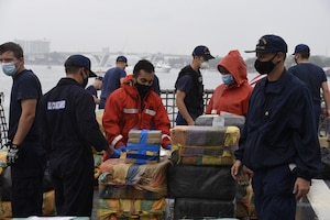 The Coast Guard Cutter Harriet Lane (WMEC-903) crew approximately offloads 11,800 pounds of cocaine and marijuana