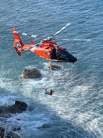 The crew of a Coast Guard Air Station Borinquen MH-65 Dolphin helicopter hoists one of five stranded kayakers