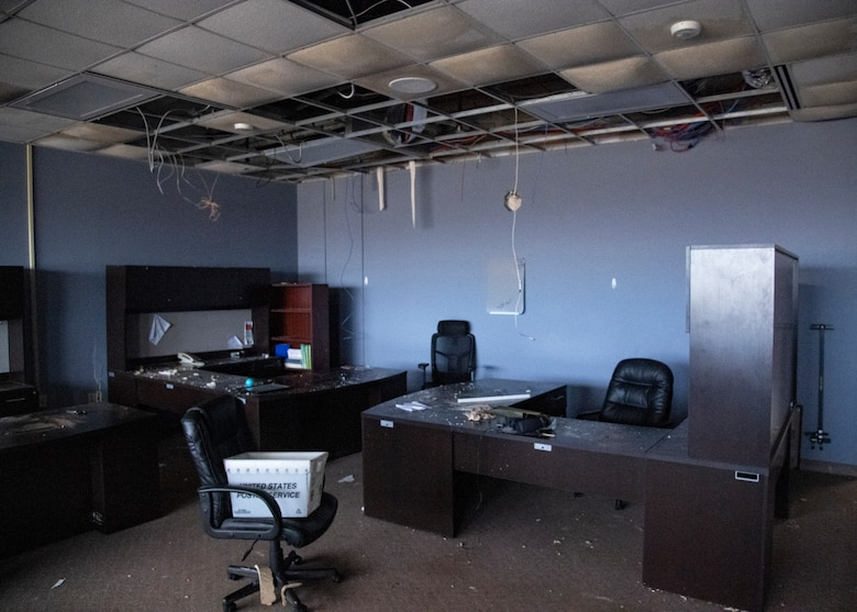 A photo of a damaged office within the Aerospace Ground Equipment schoolhouse at Sheppard Air Force Base, Texas, March 4, 2021. The Feb. 14, 2021, snowstorm damaged the AGE schoolhouse leaving it defunct. Some of AGE's labs for training have recently been cleared for use, but the main corridor that held most of the classrooms and offices for the 361st Training Squadron's faculty is still devastated and will stay unused for quite some time. (U.S. Air Force photo by Senior Airman Pedro Tenorio)