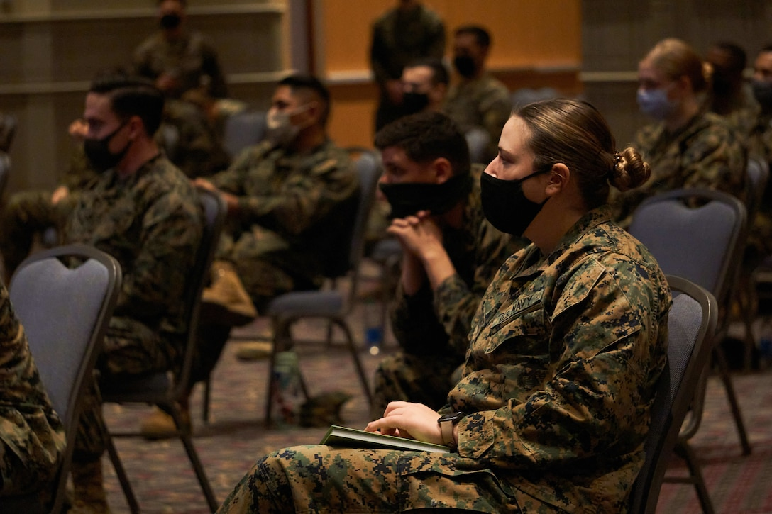U.S. Navy  Petty Officer 3rd Class Danielle L. Wendt, a hospital corpsman from Martinton, Ill., assigned to Combat Logistics Battalion 22 (CLB-22), receives the joint reception, staging, onward movement, and integration (JRSOI) brief during the setup of the state-run, federally-supported COVID-19 Community Vaccination Center at the Pennsylvania Convention Center in Philadelphia, Feb. 28, 2021. Marines and Sailors with CLB-22, from Camp Lejeune, N.C., are deployed in support of the federal vaccine response. U.S. Northern Command, through U.S. Army North, remains committed to providing continued, flexible Department of Defense support to the Federal Emergency Management Agency as part of the whole-of-government response to COVID-19 (U.S. Marine Corps photo by 1st Lt. Kevin Stapleton/ Combat Logistics Battalion 22)