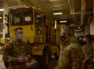 U.S. Air Force Maj. Adam Starkey, 354th Logistics Readiness Squadron (LRS) commander (left), briefs Gen. Ken. Wilsbach, Pacific Air Forces commander, on LRS Snow Fleet operations and equipment, Feb. 19, 2021, at Eielson Air Force Base, Alaska.
