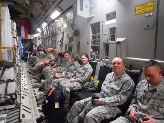 photo of Air Force Radiation Assessment Team (AFRAT) members and their equipment aboard an Air Force C-17 bound for Japan.