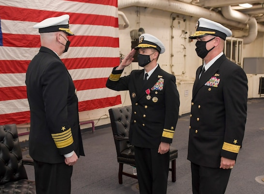Rear Adm. Brad Cooper salutes Adm. Christopher W. Grady, commander, U.S. Fleet Forces Command, during the Naval Surface Force Atlantic (SURFLANT) change of command ceremony aboard the San Antonio-class amphibious transport dock ship USS Mesa Verde (LPD 19).