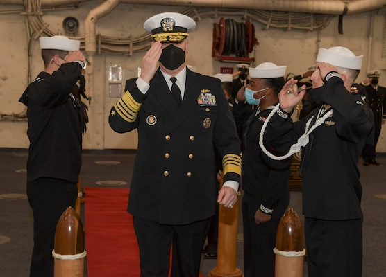 Adm. Christopher W. Grady, commander, U.S. Fleet Forces Command, salutes sideboys during the Naval Surface Force Atlantic (SURFLANT) change of command ceremony aboard the San Antonio-class amphibious transport dock ship USS Mesa Verde (LPD 19).