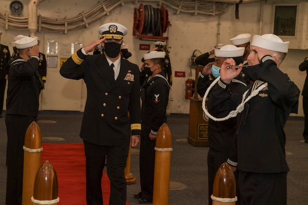 Rear Adm. Brendan McLane, commander, Naval Surface Force Atlantic (SURFLANT), salutes sideboys during the SURFLANT change of command ceremony aboard the San Antonio-class amphibious transport dock ship USS Mesa Verde (LPD 19).