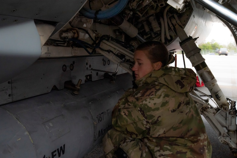 A crew chief with the 187th Fighter Wing works on an F-16 as part of a rapid deployment exercise in Dothan, Ala., March 3, 2021.