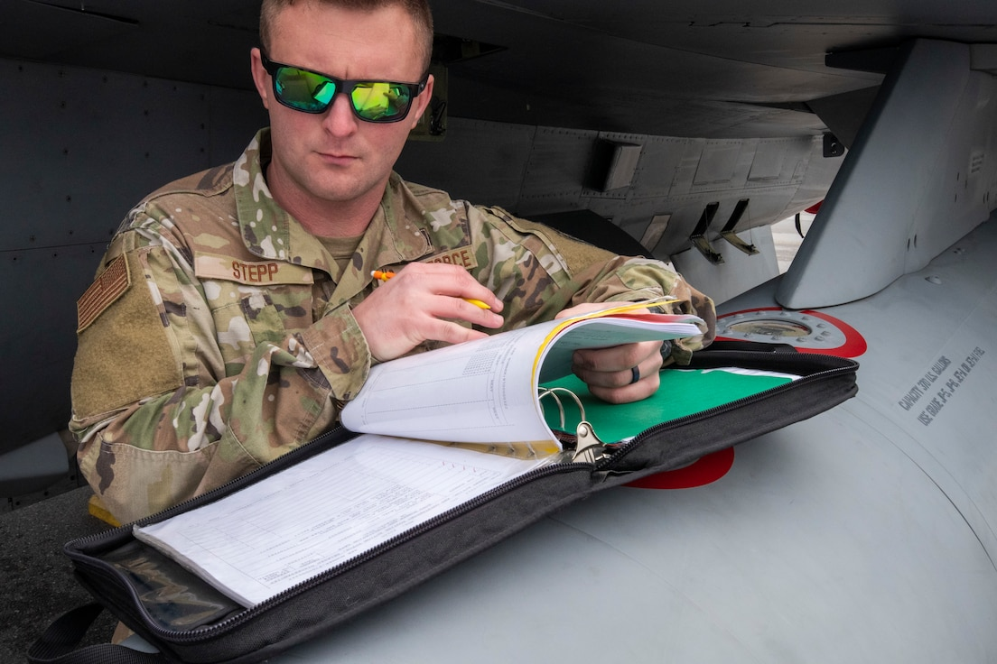 A crew chief from the 187th Fighter Wing works on an F-16C+ Fighting Falcon as part of a rapid deployment exercise in Dothan, Ala., March 3, 2021. D