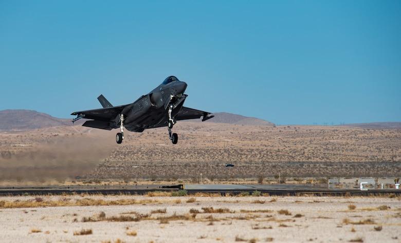 Aircraft lands on the flight line.