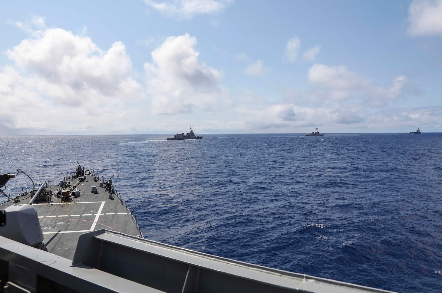 USS Benfold (DDG 65) and USS John S. McCain (DDG 56) sail in formation with the Japan Maritime Self-Defense Force guided-missile destroyer JS Shiranui (DDG 120) and helicopter destroyer JS Ise (DDH 182) during the annual U.S.-Japan Bilateral Advanced Warfighting Training Exercise.