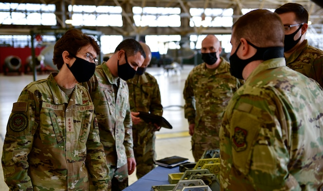 U.S. Air Force Gen. Jacqueline Van Ovost, Air Mobility Command commander, and Chief Master Sgt. Brian Kruzelnick, AMC command chief, examine the jackscrew mounting bracket created by the 92nd Maintenance Squadron aircraft metals technology shop at Fairchild Air Force Base, Washington, March 4, 2021. The AMC command team visited Fairchild as part of their listening tour to hear the questions and concerns from mobility Airmen, and communicate the importance of accelerating change throughout the Air Force. (U.S. Air Force photo by Senior Airman Ryan Gomez)