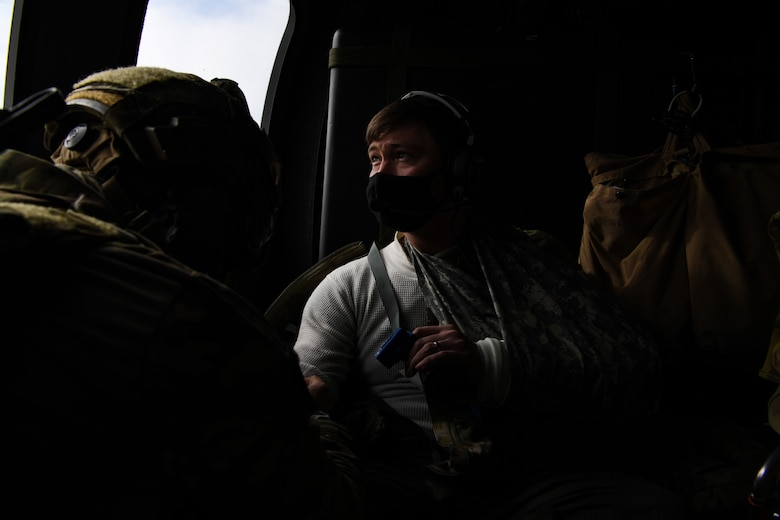 U.S. Air Force Capt. Austin Huff, 510th Fighter Squadron F-16 Fighting Falcon pilot, receives treatment for his simulated injuries during Operation Porcupine in Romania, March 4, 2021.