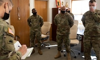 Gen. Daniel Hokanson takes notes while meeting with Vermont National Guard recruiters during a visit to the Vermont Guard Joint Task Force Headquarters Feb. 26, 2021. Hokanson recognized four recruiters for their efforts: Staff Sgt. Andrew Knapp, Sgt. Gregory Jacobs, Air Force Tech. Sgt. Renick Darnell-Martin, and Air Force Staff Sgt. Freeman Degboe. Hokanson is the chief of the National Guard Bureau. (U.S. Army National Guard photo by Don Branum)