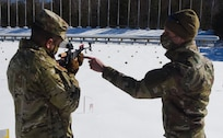 Air Force Tech. Sgt. Travis Voyer, right, familiarizes Maj. Gen. John Andonie on an Anschutz 1807 rifle used in biathlons at the Camp Ethan Allen Training Site in Jericho, Vermont, Feb. 26, 2021. Four Soldiers with the Vermont Army National Guard were sent to Austria in 2020 to represent the United States in the Biathlon Pre-World Cup. Voyer is a biathlon trainer with the 158th Logistics Readiness Squadron. Andonie is the deputy director of the Army National Guard. (U.S. Army National Guard photo by Marcus Tracy)