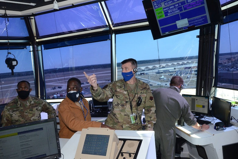 U.S. Air Force Master Sgt. Thomas Arthur (right), Tower Chief Controller, 245th Air Traffic Control Squadron, briefs U.S. Army Brig. Gen. David Jenkins (left), Assistant Adjuant General- Army and Mr. Larry Ward (center), staffer for U.S. Rep. James Clyburn during a tour March 5, 2021 at McEntire Joint National Guard Base (JNGB). The purpose of the visit was to highlight the capabilities of McEntire JNGB for federal and state response as well as the benefits McEntire JNGB provides to the citizens of South Carolina. (U.S. Air National Guard photo by Lt.Col. Jim St.Clair)