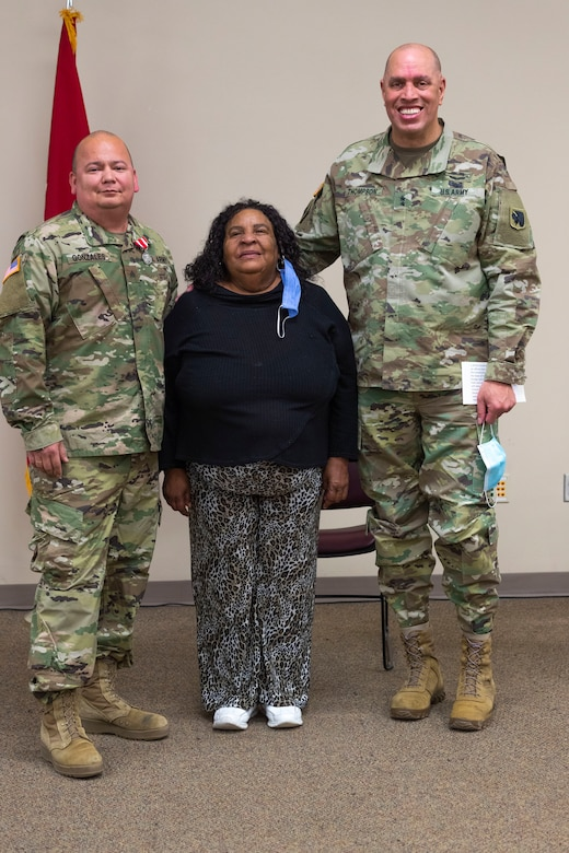Sgt. Pedro Gonzales III, member of the Oklahoma Army National Guard, receives the Oklahoma Star of Valor on Thursday at the Regional Training Institute in Oklahoma City for his heroic actions in saving his neighbor's life. In September 2020, Gonzales stepped between his neighbor and a man attacking her with a knife where he received multiple stab wounds to the face and neck. The medal is Oklahoma's second highest military award which honors Oklahoma National Guard members who carry out heroic or valorous acts, typically involving risk of life or injury in the process of protecting another in non-combat circumstances. (Oklahoma National Guard photo by Sgt. Jordan Sivayavirojna)