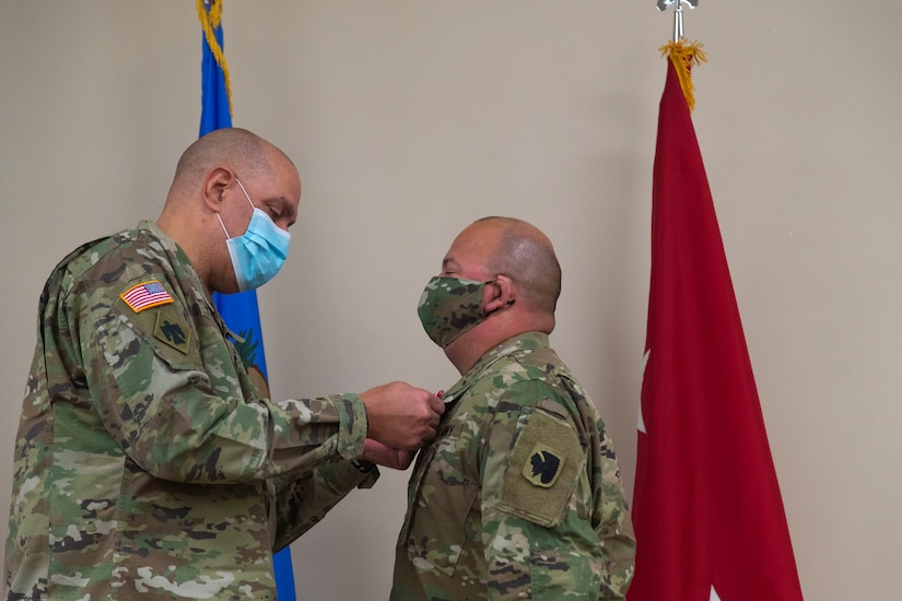 Sgt. Pedro Gonzales III (right), member of the Oklahoma Army National Guard, receives the Oklahoma Star of Valor from Maj. Gen. Michael Thompson (left), adjutant general for Oklahoma, Thursday at the Regional Training Institute in Oklahoma City for his heroic actions in saving his neighbor's life. In September 2020, Gonzales stepped between his neighbor and a man attacking her with a knife where he received multiple stab wounds to the face and neck. The medal is Oklahoma's second highest military award which honors Oklahoma National Guard members who carry out heroic or valorous acts, typically involving risk of life or injury in the process of protecting another in non-combat circumstances. (Oklahoma National Guard photo by Sgt. Jordan Sivayavirojna)