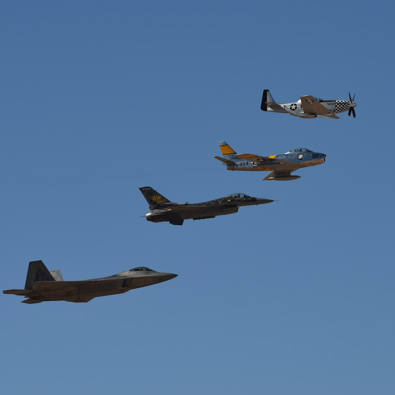 An F-22 Raptor, an F-16 Fighting Falcon, an F-86 Sabre and a P-51 Mustang in flight
