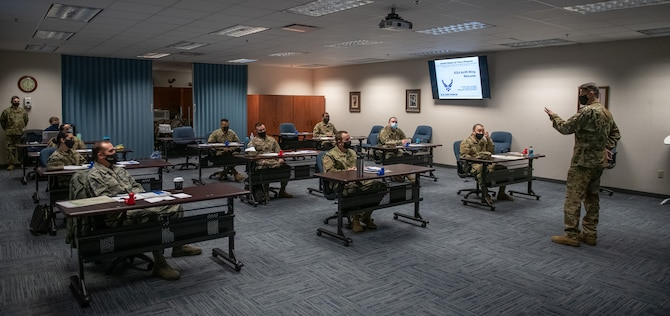 Col. Glenn Collins, 932nd Airlift Wing commander, welcomes new 932nd AW and 73rd Airlift Squadron teammates during the in-person Newcomers briefing, March 6, 2021, Scott Air Force Base, Illinois.  This was the first in-person Newcomers briefing since October due to COVID-19 restrictions. (U.S. Air Force photo by Master Sgt. Christopher Parr)