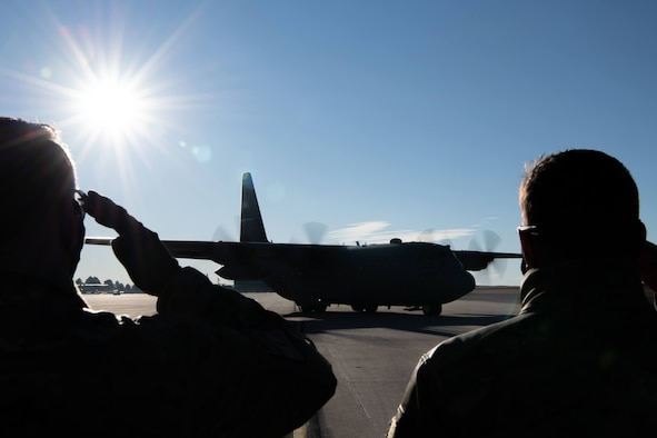 Leadership from the 302nd Airlift Wing deliver a salute to members aboard a C-130 aircraft before they depart to an undisclosured location Feb. 5, 2021, Peterson Air Force Base, Colorado.