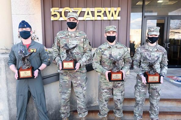 Airman holding award