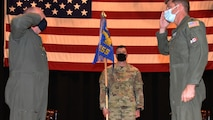 Lt. Col. Jason Helmick, right, assumes command of the 931st Operations Support Squadron during a change of command ceremony March 6, 2021, at McConnell Air Force Base, Kansas.
