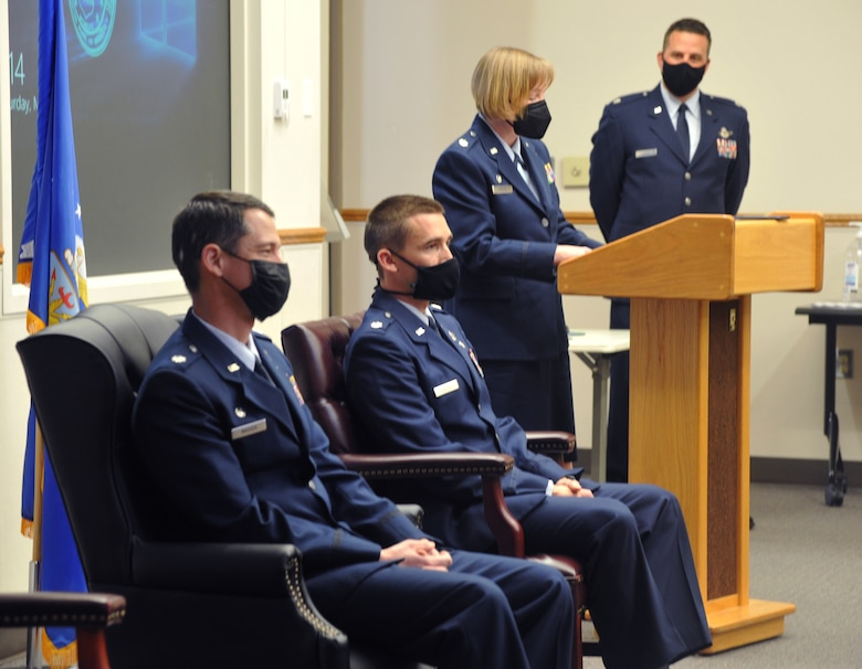 U.S. Air Force Lt. Col. Cynthia Welch, 446th Operations Group commander, officiates the 728th Airlift Squadron change of command March 6, 2021, on Joint Base Lewis-McChord, Washington, while outgoing and incoming commanders listen.