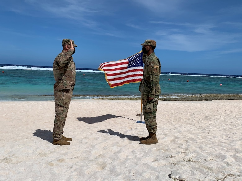 U.S. Air Force Col. Eric Schmidt, commander of the 36th Contingency Response Group, commences the enlistment of U.S. Air Force Staff Sgt. Wesley Murray, a cyber surety supervisor with the 644th Combat Communications Squadron, into the U.S. Space Force at Tarague Beach, Andersen Air Force Base, Guam, Feb. 10, 2021. Murray was a part of a multi-capable deployable communications team within the 644 CBCS. The unit is designed to deploy all or part of a 32-person team within a moment's notice to establish and provide initial non-classified internet protocol router network and secret internet protocol router network services. (Courtesy photo)