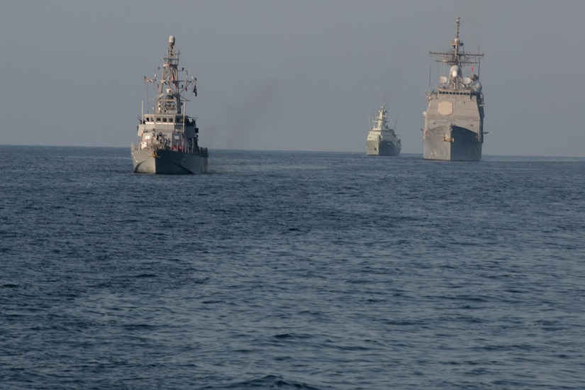210222-A-BD272-0689 SEA OF OMAN (Feb. 22, 2021) – Patrol coastal ship USS Thunderbolt (PC 12), left, guided-missile cruiser USS Port Royal (CG 73), right, and corvette RNOV Al Rasikh (Q 42)  sail in formation during coalition exercise Khunjar Hadd 26 in the Sea of Oman, Feb. 22. Khunjar Hadd 26 is an annual exercise meant to enhance mutual maritime capabilities and interoperability between the U.S., Omani, French and United Kingdom military forces in order to address threats to freedom of navigation and the free flow of international commerce. (U.S. Army photo by Spc. Theoren Neal)