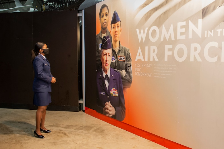 U.S. Air Force Capt. Andrea Lewis, E-8C Joint STARS pilot with the 116th Air Control Wing, Georgia Air National Guard, views her own image at a new National Museum of the U.S. Air Force exhibit at the museum on Wright-Patterson Air Force Base, Ohio, Mar. 5, 2021. The exhibit, which celebrates female aviators' accomplishments, opened in March in honor of Women's History Month. (U.S. Air National Guard photo by Master Sgt. Nancy Goldberger)
