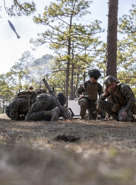 U.S. Marines with 2nd Battalion, 8th Marine Regiment, 2d Marine Division (2d MARDIV), fire a 60mm mortar during a live-fire attack on Range G-29, Camp Lejeune, N.C., March 5, 2021. This evolution included platoon level day and night live-fire training to increase proficiencies in dynamic and complex infantry skills. 2d MARDIV generates lethal forces that are able to support the full spectrum of operations around the world. Small unit leaders are entrusted by their commanders to maintain the highest levels of preparedness for global operations. (U.S. Marine Corps photo by Cpl. Elijah J. Abernathy)