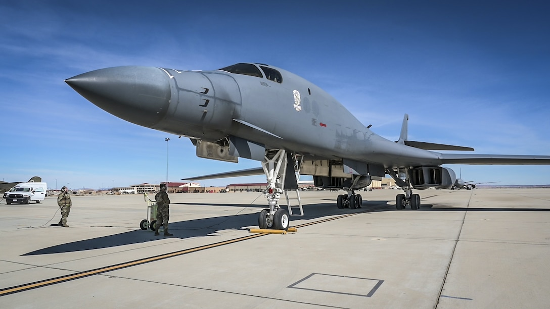 A recently retired B-1B Lancer, tail number 86-0099, begins to off-load its crew at Edwards Air Force Base, California, Feb. 23. The aircraft will become the Edwards Aircraft Ground Integration Lab, or EAGIL, a non-flyable aircraft that will be used as an integration lab for future upgrades. (Air Force photo by Giancarlo Casem)