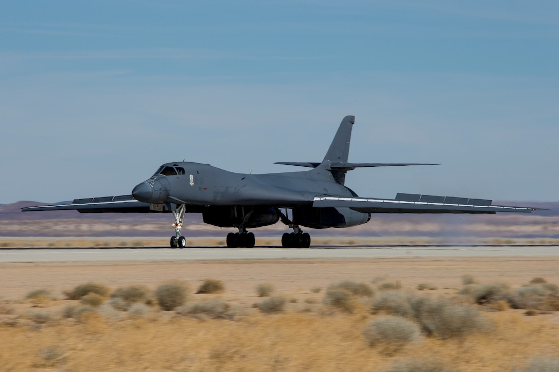 A recently retired B-1B Lancer, tail number 86-0099, lands at Edwards Air Force Base, California, Feb. 23. The aircraft will become the Edwards Aircraft Ground Integration Lab, or EAGIL, a non-flyable aircraft that will be used as an integration lab for future upgrades. (Air Force photo by May Straight)