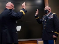 Newly promoted Col. Ronald W. Bonesz, of Normal, Illinois, recites the oath of commissioned officers administered by Maj. Gen. Michael Zerbonia, of Chatham, Illinois, Assistant Adjutant General – Army, Illinois National Guard, and Commander, Illinois Army National Guard.