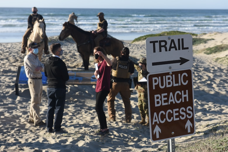 """""""Meet Surf Beach"""" attendees discuss beach access near the trail developed by Vandenberg's Civil Engineer Squadron, which connects Ocean Park to Surf Beach entryway allowing improved access to beach visitors while mitigating the disruption to wildlife on Thursday, Feb. 25, 2021."""