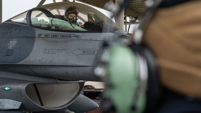 Photo of a pilot sitting in the cockpit of an F-16 Viper before being marshalled out.