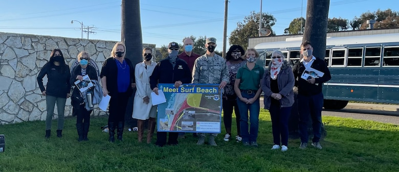 """Vandenberg Leadership stands outside Vandenberg South Base gate with """"Meet Surf Beach"""" sign following the community engagement on Feb. 25, 2021."""