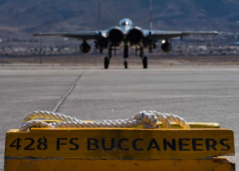 An F-15SG Strike Eagle from the 428th Fighter Squadron taxis onto a runway.