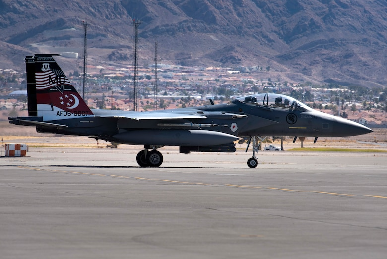 An F-15SG Strike Eagle from the 428th Fighter Squadron taxis on a runway.