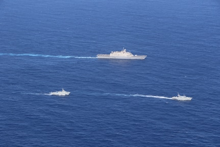 USS Wichita (LCS 13) executes a passing exercise (PASSEX) with Dominican Republic patrol boats Orion (GC 109) and Altair (GC 112) while operating in the Caribbean Sea, March 2, 2021.