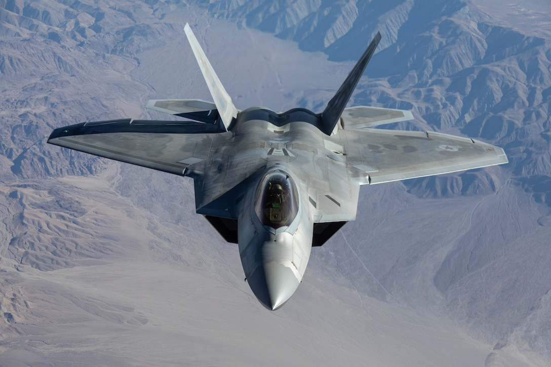 A F-22 Raptor from the 422nd Test and Evaluation Squadron at Nellis Air Force Base, Nevada, participates in Orange Flag, March 2, 2021. Orange Flag, the large force test event carried out three times annually by Air Force Test Center's 412th Test Wing at Edwards AFB, Calif., combined with the 53rd Wing's Black Flag, brought several firsts for the test community March 2-4.