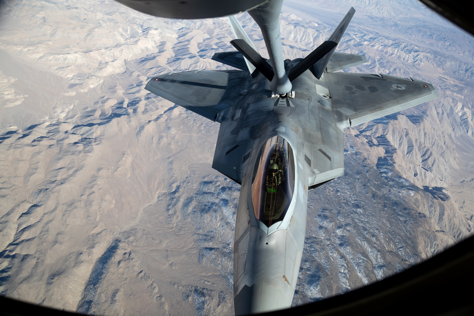 A F-22 Raptor from the 422nd Test and Evaluation Squadron at Nellis Air Force Base, Nevada, refuels during Orange Flag, March 2, 2021. Orange Flag, the large force test event carried out three times annually by Air Force Test Center's 412th Test Wing at Edwards AFB, Calif., combined with the 53rd Wing's Black Flag, brought several firsts for the test community March 2-4.