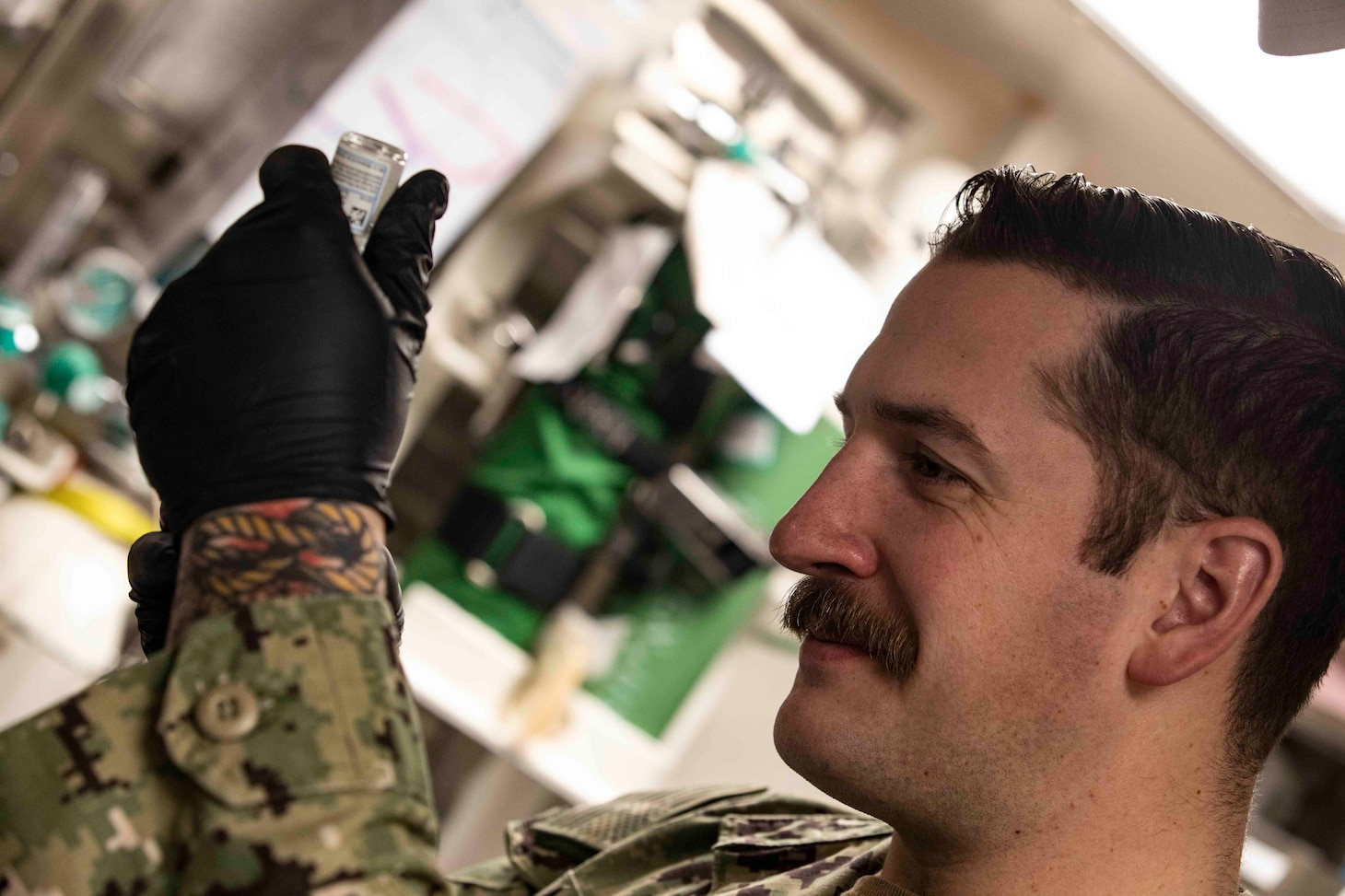 210220-N-BM428-0143 SOUDA BAY, Greece (Feb. 20, 2021) Hospital Corpsman 3rd Class Zak McBride, assigned to Naval Hospital Souda Bay, prepares a COVID-19 vaccine for use aboard the Arleigh Burke-class guided-missile destroyer USS Porter (DDG 78) in Souda Bay, Greece, Feb. 20, 2021. Porter, forward deployed to Rota, Spain, is on its ninth patrol in the U.S. Sixth Fleet area of operations in support of U.S. national interests and security in Europe and Africa. (U.S. Navy photo by Mass Communication Specialist 2nd Class Damon Grosvenor)