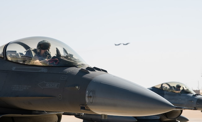 A pilot with the 77th Expeditionary Fighter Squadron pilot, prepares for flight during an Agile Combat Employment capstone event Feb. 27, 2021, at an airbase in the Kingdom of Saudi Arabia.