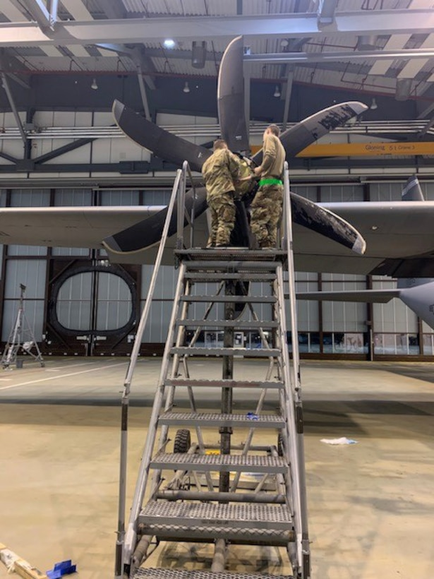 U.S. Air Force Airmen assigned to the 86th Maintenance Squadron and the 86th Aircraft Maintenance Squadron inspect a C-130J Super Hercules aircraft propeller during maintenance procedures